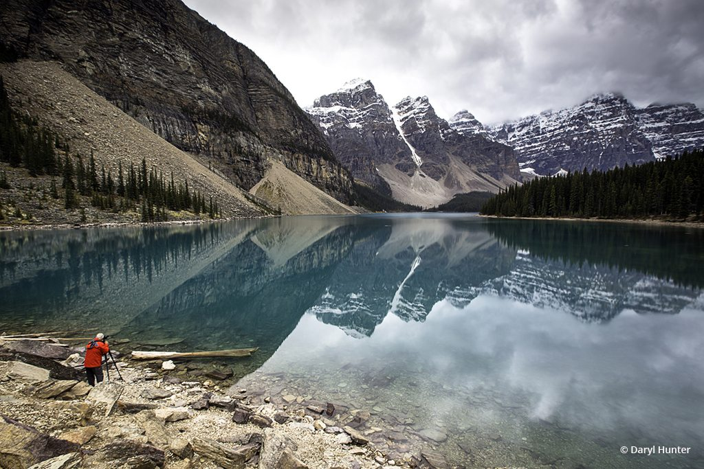 """Today's Photo Of The Day is """"Photographer, Moraine Lake"""" by Daryl Hunter. Location: Banff National Park, Alberta, Canada."""