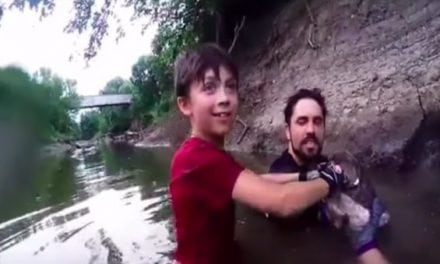 Young Noodler Pulls Catfish Bigger Than Him Out of a Cave