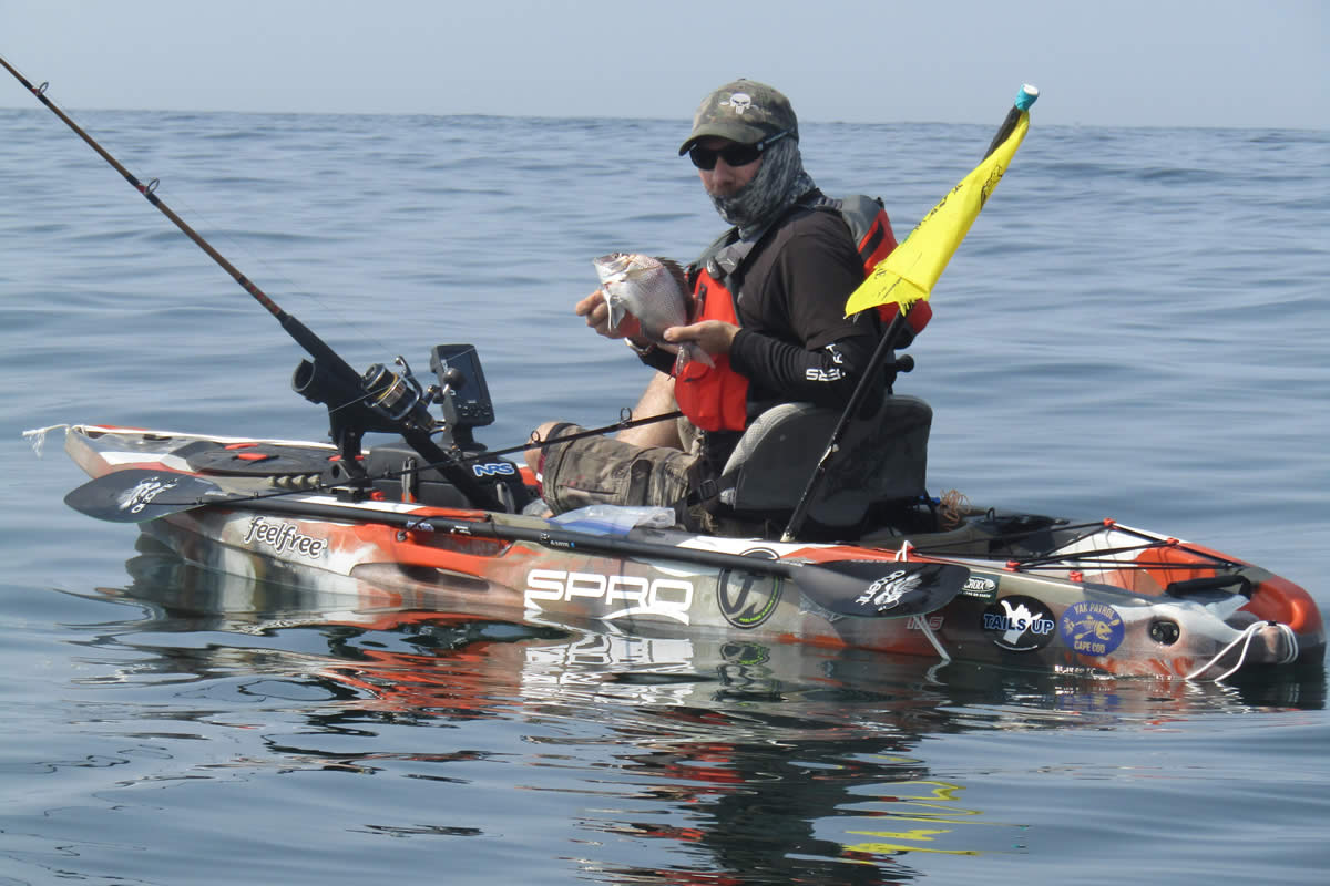 Kayak angler Ryan Dubay in a well equipped, well balanced kayak with a safety flag