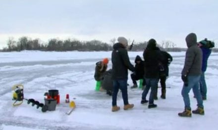 Tourists for the Super Bowl Captivated by Ice Fishing