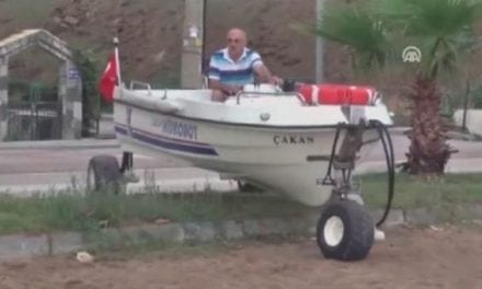 Watch This Guy's Leisurely Drive Down the Road in His Boat
