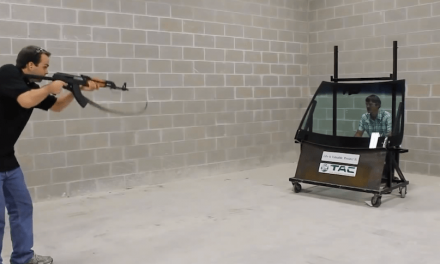 """CEO Stares Down an AK-47 Through Bulletproof Glass to """"Stand Behind"""" His Product"""