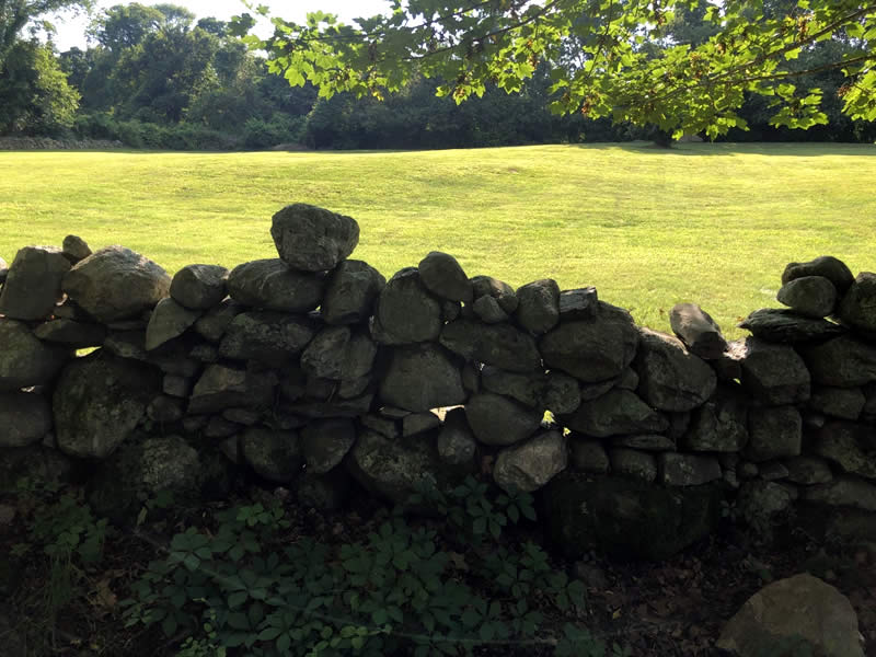 Is there writing on the stone wall for stripers?