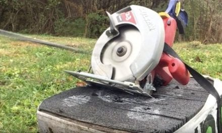 Man Shoots a Circular Saw With a Compound Bow