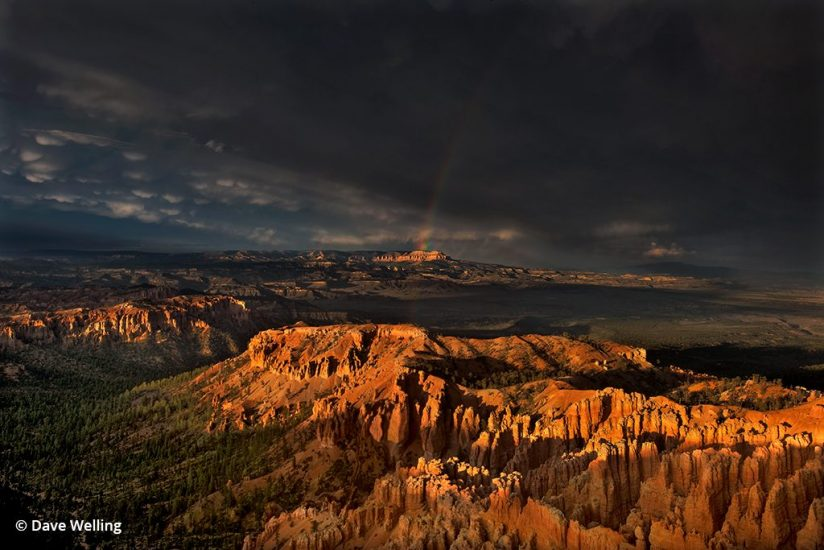 Monsoon photo of a rainbow over Bryce Canyon.
