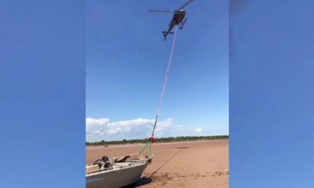 Helicopter Drags Stranded Boat Back to the Water