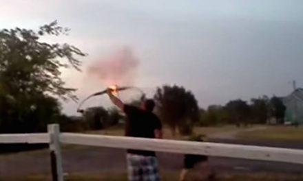 Guy Lights an Artillery Shell on the End of an Arrow