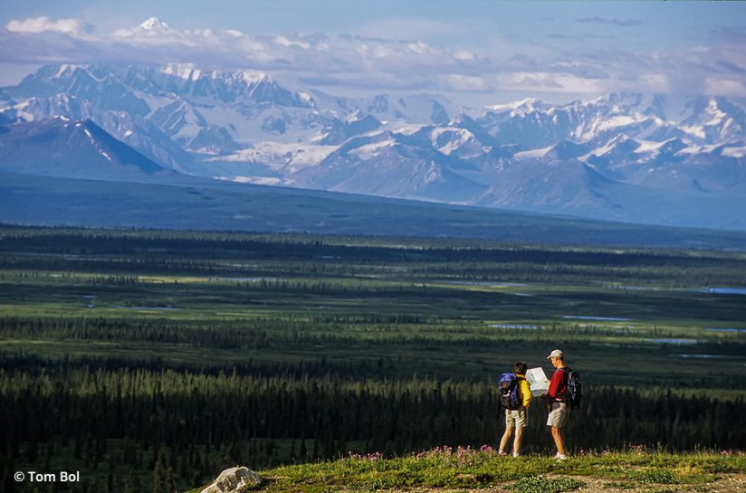 adventure photography, image of hikers checking a map