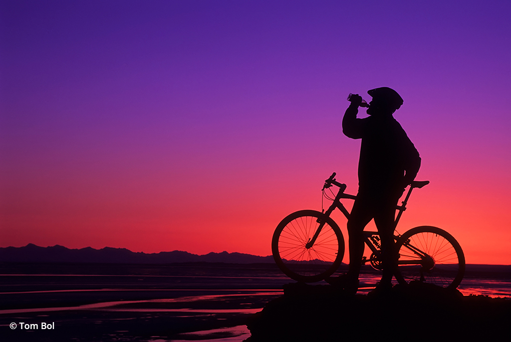 adventure photography, biker at sunset