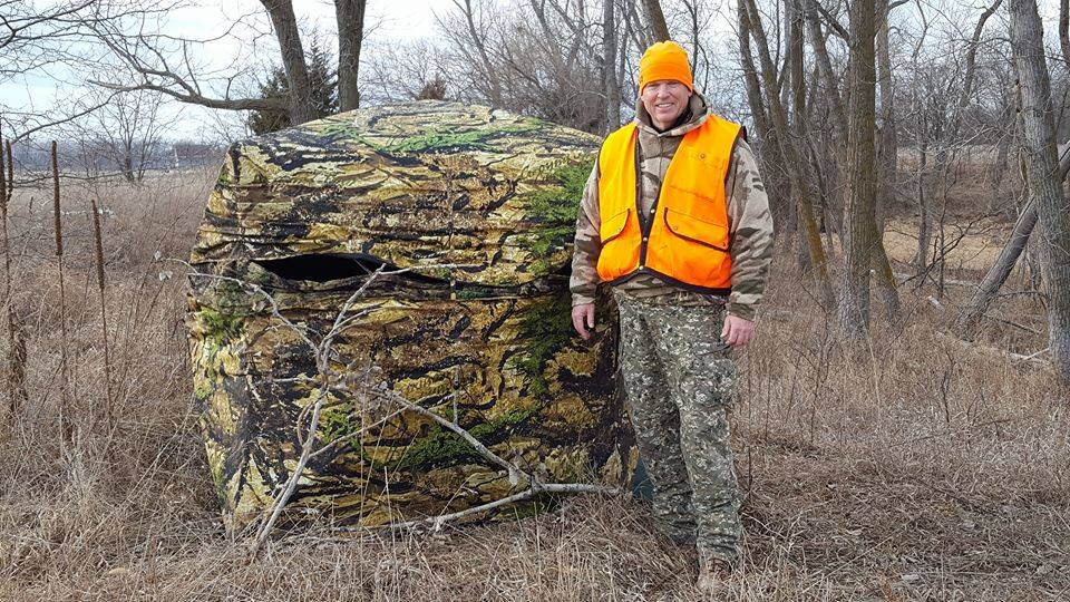 Nebraska Conservation Officer Rich Berggren poses for a photo before entering his muzzleloader deer hunting season blind in his off time.